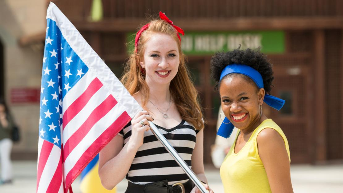 two students holding the american flad